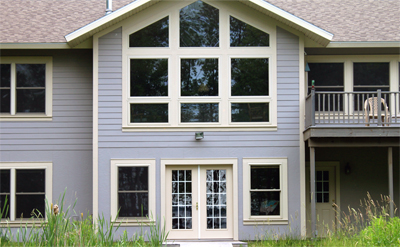 Residential Contruction Services for the Eastern Upper Peninsula: Lakeside Home with Custom Windows and Floor Plan